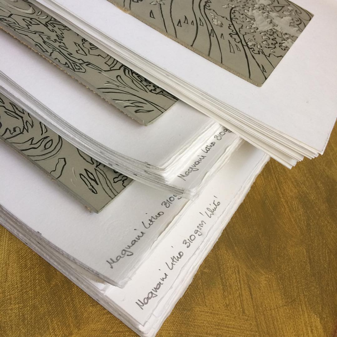 Stack of paper and lino blocks