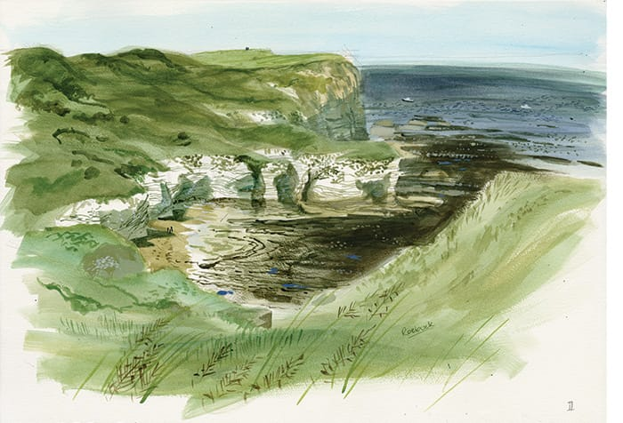A glorious sunny day shows the tide in beneath the cliffs