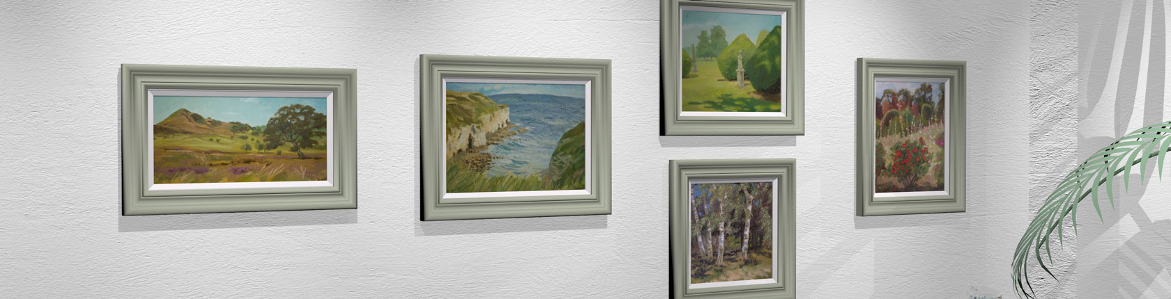 Plein air paintings on display in a gallery space