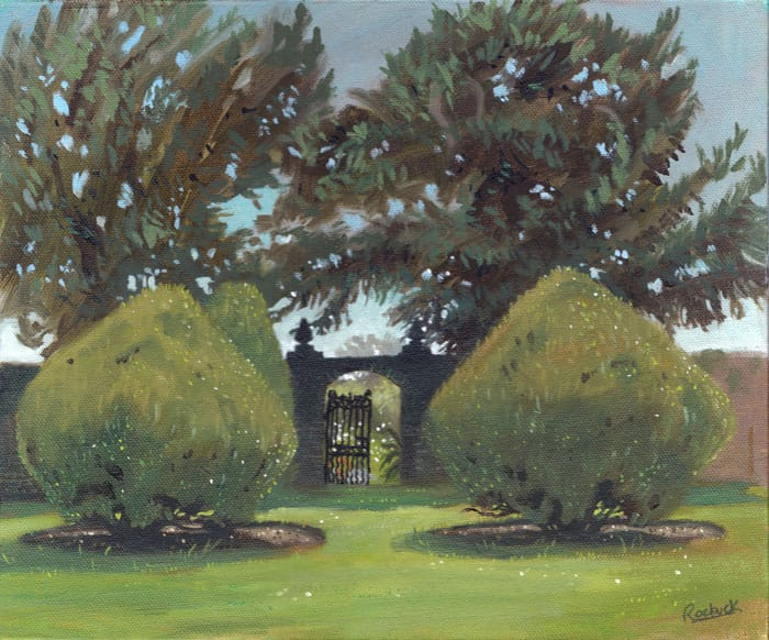 Two formal yew trees stand either side of a gate to a colourful walled garden